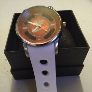 Red and white mens Nike sports watch
